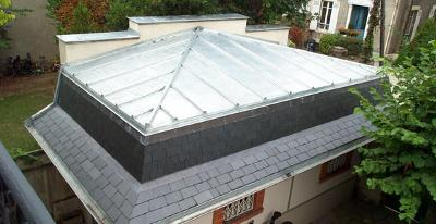 Réalisation d'un terrasson en zinc avec brisis en ardoise