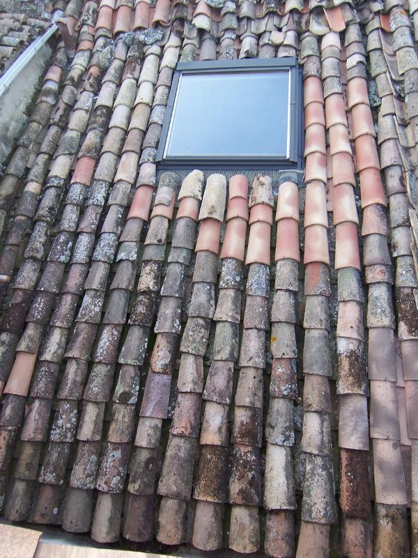 Pose d'un Velux sur toiture ancienne