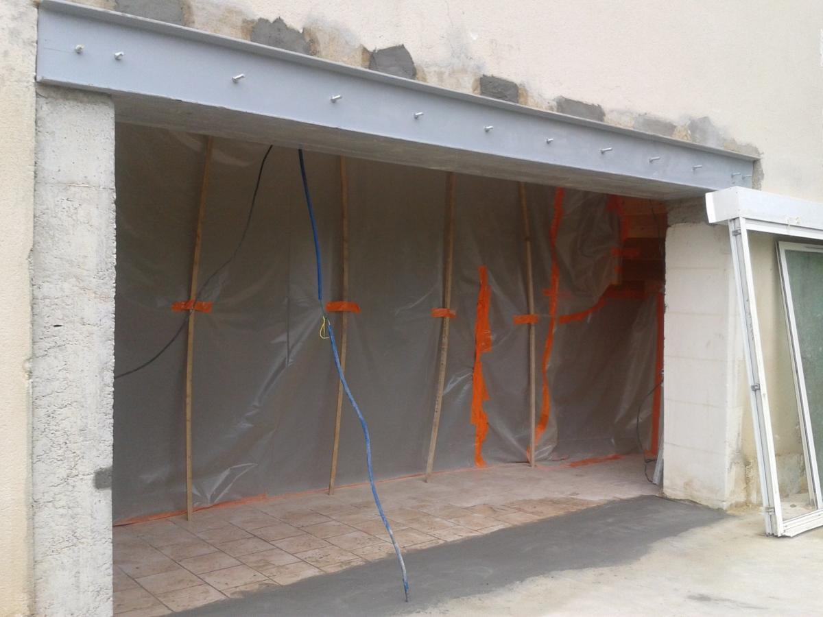Agrandissement d'une ouverture dans une façade